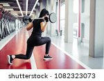 attractive woman doing lunge... | Shutterstock . vector #1082323073