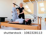 sporty young man doing pilates... | Shutterstock . vector #1082328113