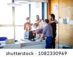colleagues making fun of... | Shutterstock . vector #1082330969
