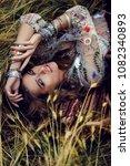 beautiful hippie girl lying in... | Shutterstock . vector #1082340893