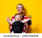 little baby in carrier and... | Shutterstock . vector #1082346896