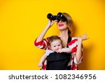 little baby in carrier and... | Shutterstock . vector #1082346956