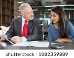 mentor training young female... | Shutterstock . vector #1082359889