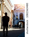 Small photo of Concept of religion and appeal to God. Silhouette of an unidentified man, who praying near the church