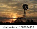 A Kansas Sunset With A Windmil...