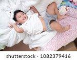 3 years old little cute asian... | Shutterstock . vector #1082379416