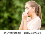 woman with allergy or a cold... | Shutterstock . vector #1082389196