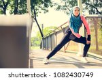 islamic woman stretching after... | Shutterstock . vector #1082430749