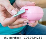 woman's hands with an electric...   Shutterstock . vector #1082434256
