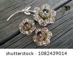 Small photo of A vintage set of jewelry made of brooches and clips. Flower concept. Bijouterie. Period 60-ies of the 70-ies of the XX century.