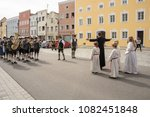 Small photo of Neuoetting,Germany-May 1,2018The parish priest and altar boys and girls prepare to waylay the parade in order to negotiate a ransom before allowing them to continue their way .