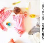 Small photo of Baby girl is sleeping on the bed. Newborn baby girl