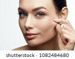 healthy skin. beautiful woman... | Shutterstock . vector #1082484680