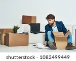 man with boxes on the floor ... | Shutterstock . vector #1082499449