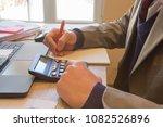 businessman using a calculator... | Shutterstock . vector #1082526896