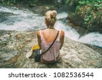young blonde female sitting on... | Shutterstock . vector #1082536544