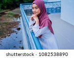 attractive young woman wearing...   Shutterstock . vector #1082538890