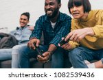 multiethnic friends with... | Shutterstock . vector #1082539436