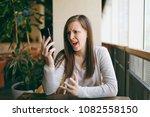 beautiful upset woman sitting... | Shutterstock . vector #1082558150