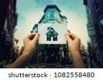 woman hands holding a paper... | Shutterstock . vector #1082558480