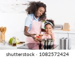 african american mom and... | Shutterstock . vector #1082572424
