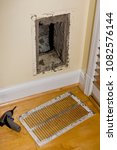 Small photo of ARLINGTON, VIRGINIA, USA - JULY 2, 2009: Dirty return duct, during duct cleaning in home.