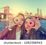 teen girls portrait with donuts ... | Shutterstock . vector #1082588963