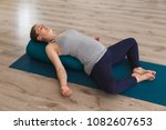 young woman lying on yoga mat... | Shutterstock . vector #1082607653