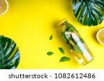 monstera leaves and bottle... | Shutterstock . vector #1082612486