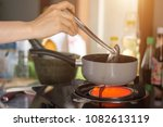 close up woman hand cooking... | Shutterstock . vector #1082613119