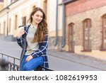 smiling woman drinking coffee... | Shutterstock . vector #1082619953