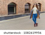 elegant woman in blue jeans and ... | Shutterstock . vector #1082619956