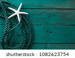 Small photo of Summer time sea vacation background with star fish and marine rope. Retro toned