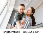 mom and son playing at home.   Shutterstock . vector #1082651534