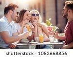 friends having a great time in... | Shutterstock . vector #1082668856