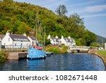 Blue Sailboat Moored Near...