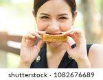 Beautiful Woman Eating Whole...