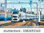 high speed train arrives on the ... | Shutterstock . vector #1082692163