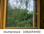 a tree reflection in the... | Shutterstock . vector #1082693450