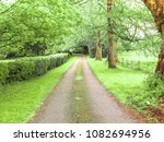 long driveway in the country... | Shutterstock . vector #1082694956