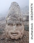 Small photo of Ruined ancient stone statue of Heracles on the top of Nemrut mount, Central Anatolia, Turkey