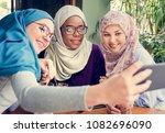 islamic women friends taking... | Shutterstock . vector #1082696090