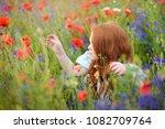 a cute girl in field of...   Shutterstock . vector #1082709764