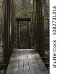 Small photo of Suspension bridge on foot trail in Crowley's Ridge State Park