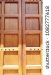 wooden door and doorknob   Shutterstock . vector #1082777618