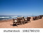 row of bamboo chaise lounge on ...   Shutterstock . vector #1082780153