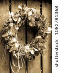 Old Wreath At A Door
