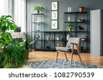 gray armchair on patterned rug... | Shutterstock . vector #1082790539