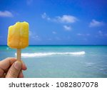 hand holding ice cream with... | Shutterstock . vector #1082807078
