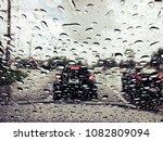 rain drops on the car win... | Shutterstock . vector #1082809094